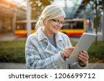 senior woman using tablet ... | Shutterstock . vector #1206699712
