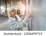 senior woman using tablet ... | Shutterstock . vector #1206699715