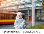 senior woman using tablet ... | Shutterstock . vector #1206699718