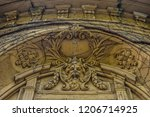 arc with sculpture and climbing ... | Shutterstock . vector #1206714925