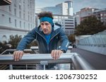 mature jogger with headband... | Shutterstock . vector #1206730252
