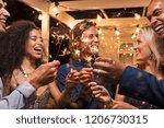 friends celebrating christmas... | Shutterstock . vector #1206730315