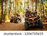 Two Atv Riders  Speed Race In...