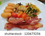 Breakfast and simple food in the garden. - stock photo