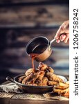 fried chicken wings with fries... | Shutterstock . vector #1206758242