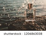perfume with water drops at sea ... | Shutterstock . vector #1206863038