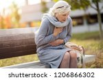 senior woman suffering from... | Shutterstock . vector #1206866302