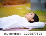 woman sleeping on grass during...