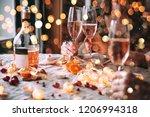 friends celebrating christmas... | Shutterstock . vector #1206994318