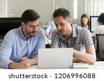 focused serious male coworkers... | Shutterstock . vector #1206996088