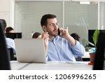 male entrepreneur making call... | Shutterstock . vector #1206996265