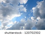 dramatic cloudscape. Blue sky with ornamental clouds - stock photo