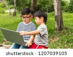 happy asian kids in glasses and ... | Shutterstock . vector #1207039105
