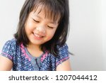happy little asian girl child... | Shutterstock . vector #1207044412