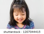 happy little asian girl child... | Shutterstock . vector #1207044415