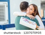 beautiful happy young woman... | Shutterstock . vector #1207070935