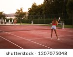couple playing tennis at the... | Shutterstock . vector #1207075048