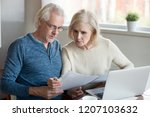 serious aged husband and wife...   Shutterstock . vector #1207103632