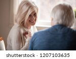 close up of smiling aged woman... | Shutterstock . vector #1207103635