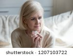 sad aged lady crying sitting on ...   Shutterstock . vector #1207103722