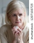 upset aged woman lost in... | Shutterstock . vector #1207103725