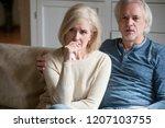 emotional senior husband and... | Shutterstock . vector #1207103755