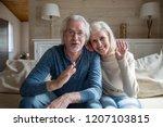 happy senior couple wave having ... | Shutterstock . vector #1207103815