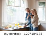 caring aged husband feed loving ... | Shutterstock . vector #1207104178