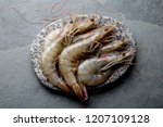 raw whole fresh uncooked prawns ... | Shutterstock . vector #1207109128