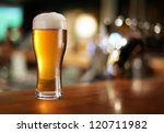 Stock photo glass of light beer on a dark pub 120711982