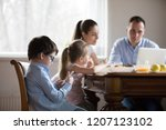 family with little children... | Shutterstock . vector #1207123102