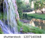 close shot of the waterfall... | Shutterstock . vector #1207160368