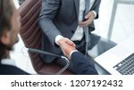 handshake business partners in... | Shutterstock . vector #1207192432