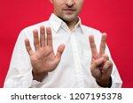 attractive guy shows seven...   Shutterstock . vector #1207195378