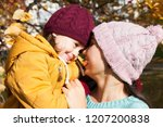 happy family mother and child... | Shutterstock . vector #1207200838