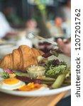 breakfast is in a cafe   Shutterstock . vector #1207201762