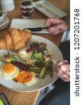 breakfast is in a cafe   Shutterstock . vector #1207201768