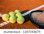 balls and tennis racket on clay ... | Shutterstock . vector #1207243675