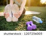 mature woman practicing yoga...   Shutterstock . vector #1207256005