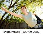 mature woman practicing yoga...   Shutterstock . vector #1207259002