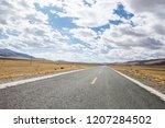 fall woods road   Shutterstock . vector #1207284502