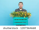 caucasian male gardener with... | Shutterstock . vector #1207364668