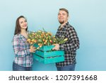 happy man and woman florists... | Shutterstock . vector #1207391668