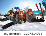 group of happy skiers together... | Shutterstock . vector #1207514038