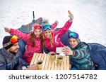 skiing family laughing and... | Shutterstock . vector #1207514782