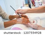 close up of beautician applying ... | Shutterstock . vector #1207554928