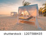 white beach canopies at sunset. ... | Shutterstock . vector #1207588435
