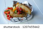 baked in foil potato with...