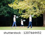 family with tennis racket | Shutterstock . vector #1207664452