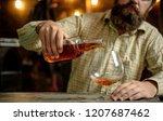 alcohol addiction. bearded man... | Shutterstock . vector #1207687462